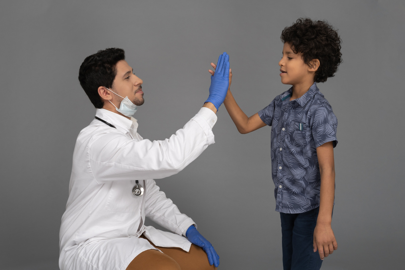 Doctor giving high five to a boy