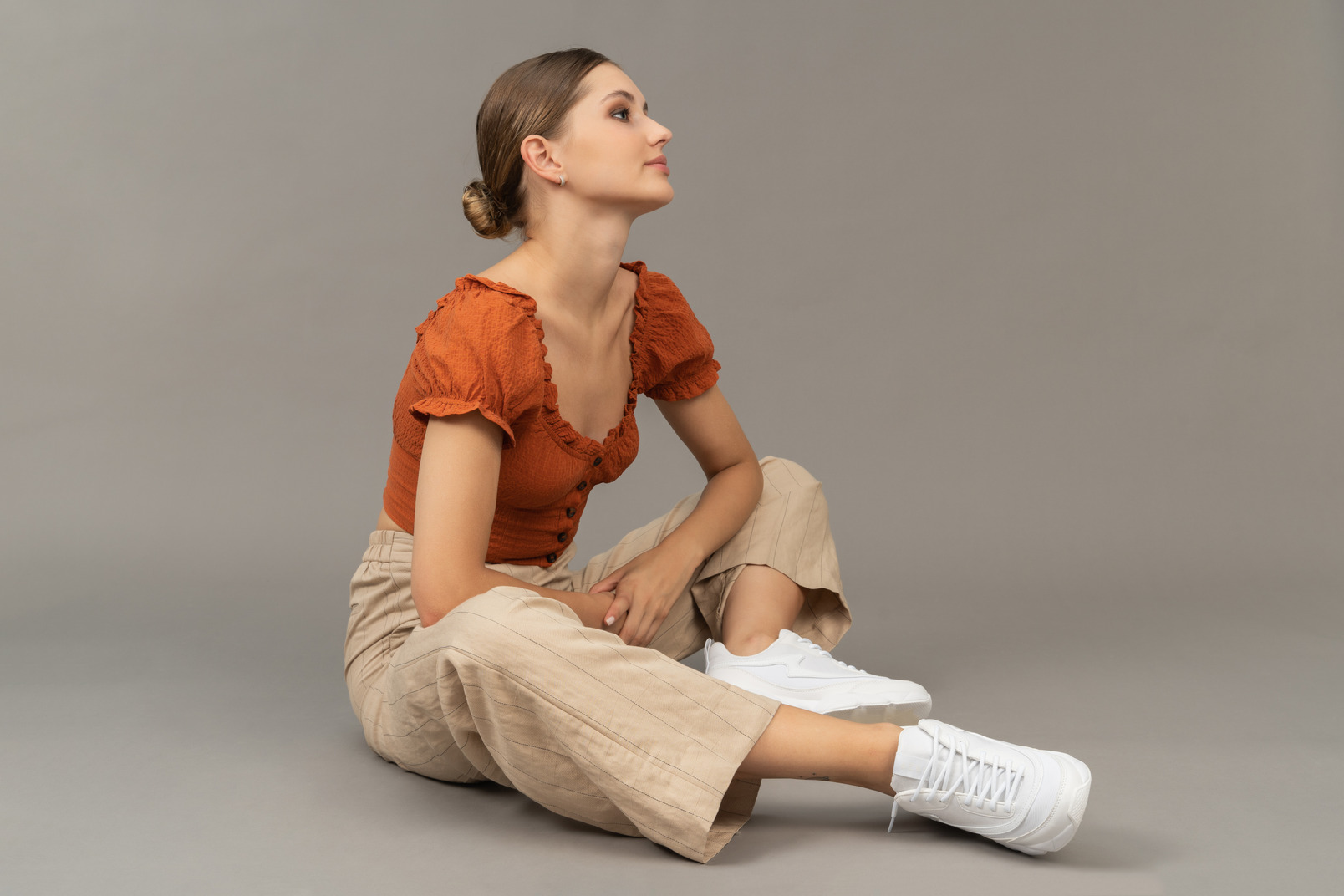 Young woman sits while looking away