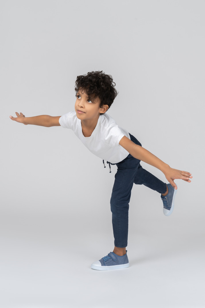 A boy standing on one leg and balancing with hands