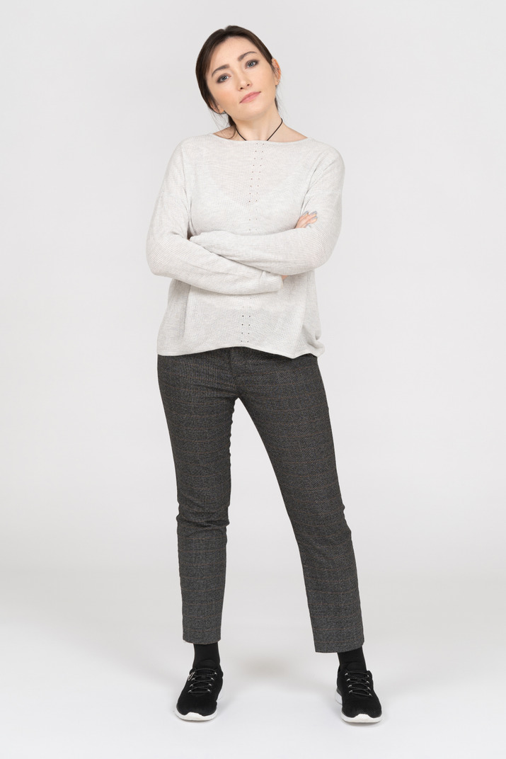 Caucasian woman posing with folded arms